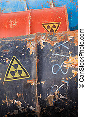 Nuclear Waste - Banged up steel barrels containing...