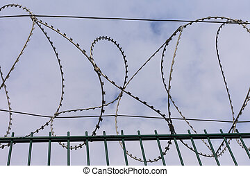 High-Security Fencing - High-security fence with razor wire...