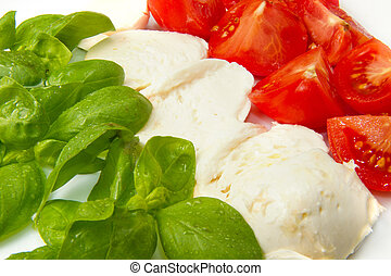 mozzarella with tomtoes and basil - Italian flag made wit...