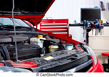 Auto service - Car with open hood in auto repair shop.