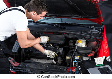 Auto repair - Handsome mechanic working in auto repair shop