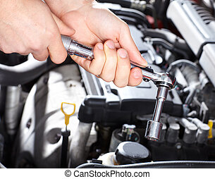 Auto service - Hand with wrench Mechanic Auto repair shop