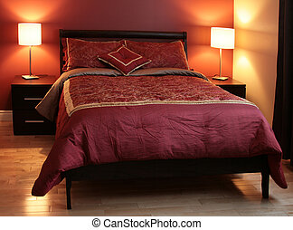 Bedroom furniture - Bedroom staged with large bed. night...