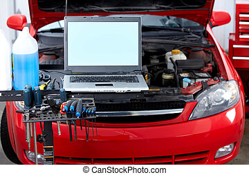 Auto repair - Car with open hood in auto repair shop.