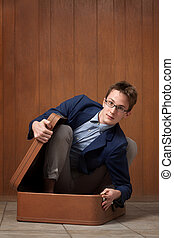 Young Man In Suitcase - Young Caucasian man stuck in a...