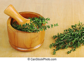 Thyme with Mortar - Fresh thyme with wooden mortar and...