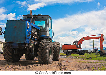 Old tractor and excavator