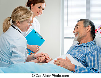 medical exam - doctor examining a senior patient in hospital...