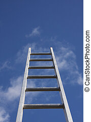 Climbing the property ladder - Bright silver ladder against...