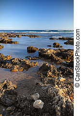 Rough shoreline - Picture of a rough rocky shoreline under a...