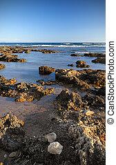 Rough shoreline - Picture of a rough rocky shoreline under a...