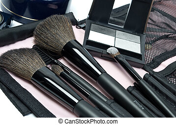 Cosmetics - the eye shadows and makeup brushes.