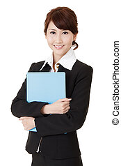 Friendly executive woman of Asian smiling and holding file...