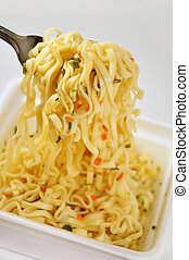 Appetizing Instant noodles with spices Noodles on a fork