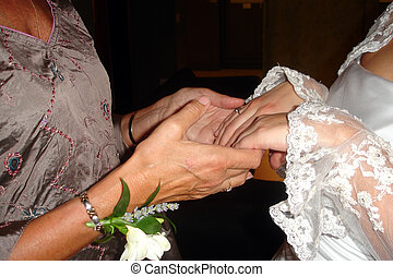 soothing hands - A mother holds her daughters hands tenderly...