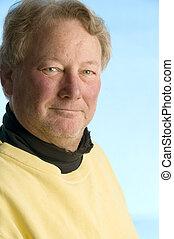 handsome smiling middle age senior man worn turtleneck shirt