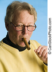 handsome middle age senior man smoking expensive cigar...