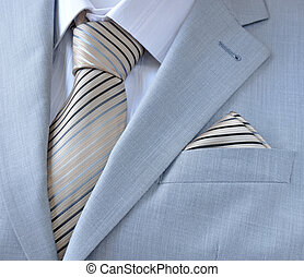 piece suit with white shirt, tie, scarf, close-up