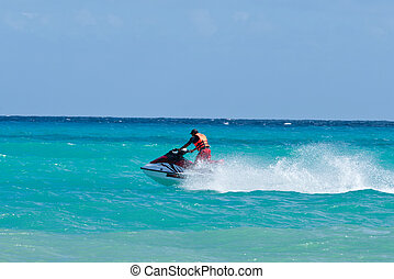 Man riding jet ski in Caribbean sea