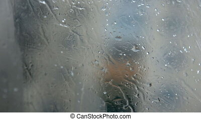 Rain and snow - Snowflakes and raindrops over glass