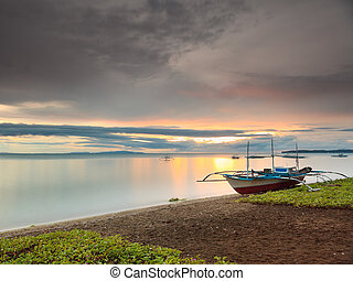 Philippine sunset - Sunset over the sea. Boat on the...