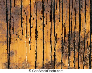 crude oil background - old rusty metal surface with crude...