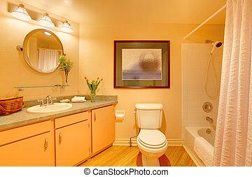 Yellow  cozy bathroom with orange cream colors