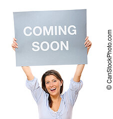 Comin soon - A portrait of a young happy woman holding a...