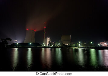 Power plant at night - The picture shows a coal plant at...
