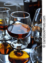 Brandy and candles - a glass of brandy and a candle,...