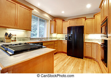 Kitchen with open floor plan and black appliances
