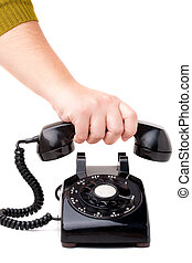 Hanging Up the Phone - A hand hanging up the handset of an...