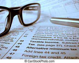 Financial Image Of A Tax Form, Pen And Glasses
