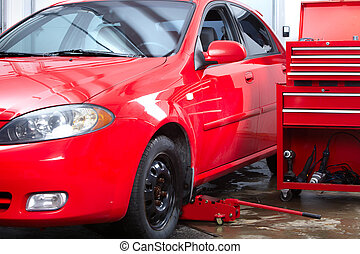 Auto service - Red car in auto repair shop. Repair.