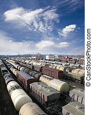 Railway station - Railroad cars on a railway station. Cargo...