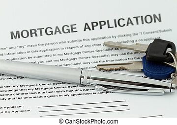 Mortgage Application with pen and key in a mortgage form