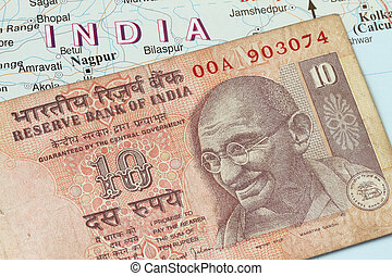 Indian currency - Indian rupees against the map background