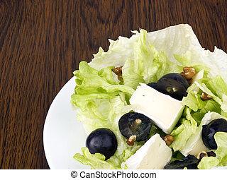 Tasty salad on white plate