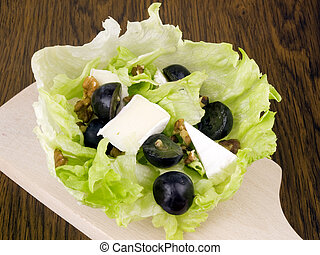 Tasty salad with camembert cheese
