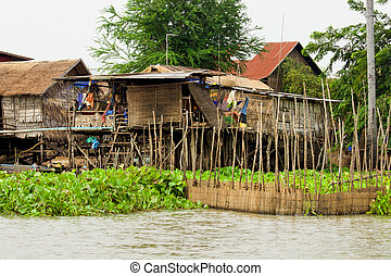 Wooden Houses on Stilts - Traditional fishermen wooden...