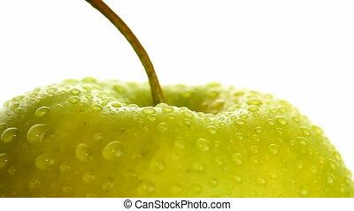 wet apple on white