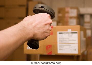 Barcode scaner in man hand