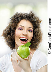 green apple - A beautiful slender girl eating healthy food