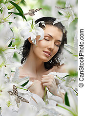 flower girl - a beautiful girl in the flower garden