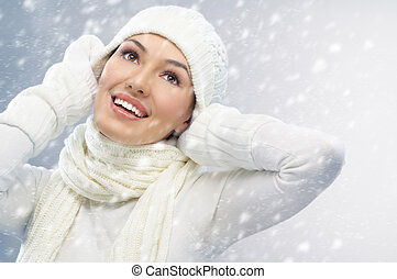 wintertime - a beauty girl on the snow background
