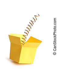 Jump Out - Metal spring inside open yellow paper box...