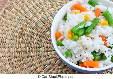 Bowl with cooked rice with mixed vegetable - Close up view...