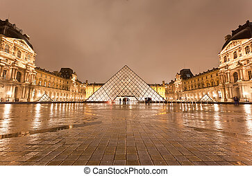 The Louvre Museum at the rainy night - PARIS - DECEMBER 7:...