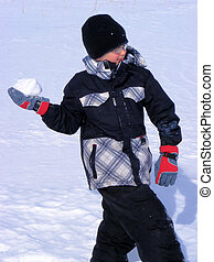 Boy throwing snowball - Young boy throwing a snowball