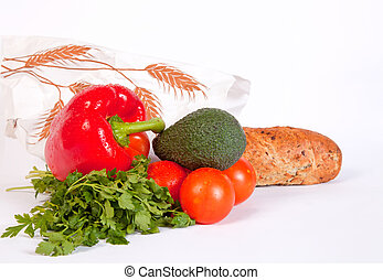 Pile of ripe vegetables and baguette in paper bag - Pile of...